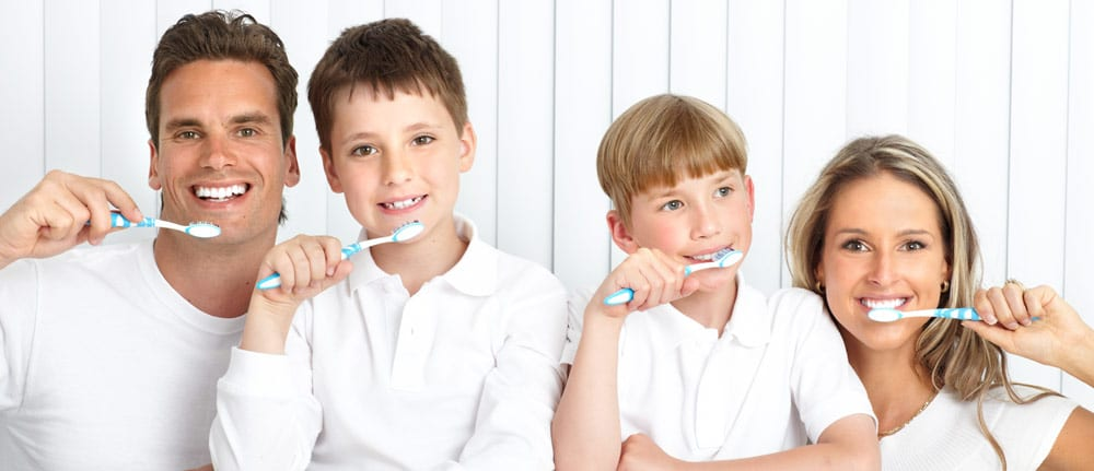 St Petersburg General Dentist - Photo of a family brushing their teeth.